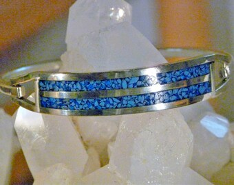Sterling silver and inlaid turquoise hinged bangle bracelet