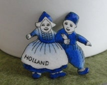 B570)  Vintage Blue and White Enamel Dutch Holland Girl and Boy Pin