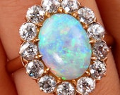 An exquisite 2.54ct Authentic Antique Edwardian Australian Opal and Diamond Cluster Cocktail Ring