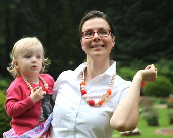Set of 2. Natural wooden necklace and small child necklace. Orange, red and rosa partner look set