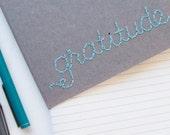 Embroidered Gratitude Journal, featuring custom artwork on kraft Moleskine. made to order.