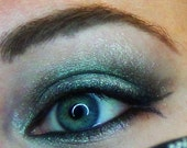 Bioexorcist Eyeshadow- Silver with a Color Morphing Base and Green Sparkles