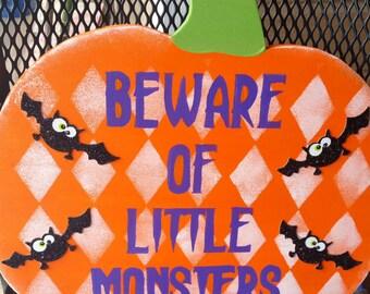Very cute beware of little monsters pumpkin decor