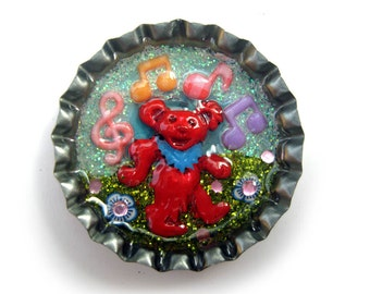 Grateful Dead pin, dancing bear hat pin, let there be songs, handmade and one of a kind, enamelled bear in bottlecap with music and flowers