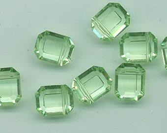 8 vintage Swarovski crystal beads - Art. 5105 - 12.5 x 10 mm - chrysolite