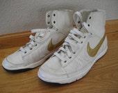 Nike vintage high top tennis shoes.  Size 9.  Ladies clothing.