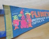 Vintage Flintstones tourism banner.  Custer, SD.