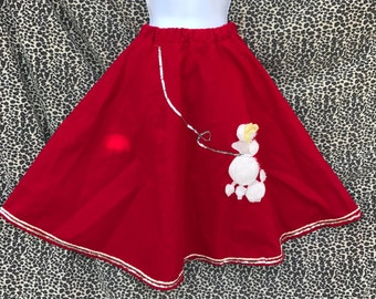 Vintage Red Poodle Skirt Costume. Vibrant Red Flannel with White Fuzzy Poodle and Sequin Embellishment. Elastic Waist. Extra Small/Small