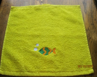 Yellow washcloth facecloth with embroidered fish