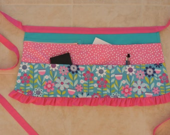 Vendor apron in blue and pink floral with pink ruffle