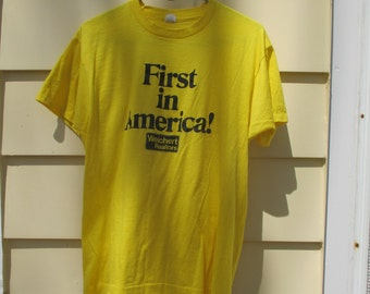 Vintage 1980s First is America Weichert Realty Tee Shirt Yellow Cotton