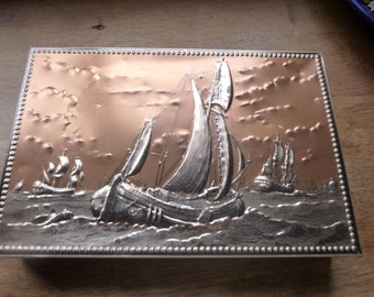 Vintage French Storage Tin with Maritime Historic Tall Ship Boat Scene Raised in Relief with Printed Detail.