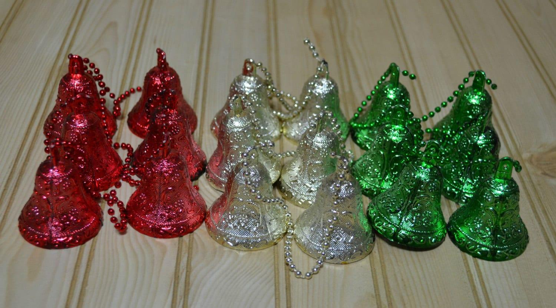 Vintage hard plastic bell ornament garland red green gold