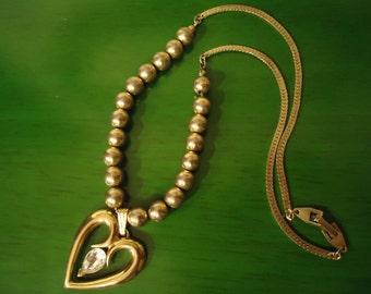 Vintage 1980s Boho Chic Gold Bead Necklace with Rhinestone Heart shaped Pendant