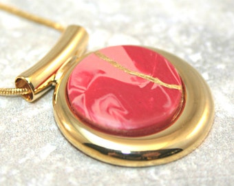 CLEARANCE SALE - Kintsugi (kintsukuroi) pendant in swirled red polymer clay with gold repair in a fancy gold plated setting - OOAK