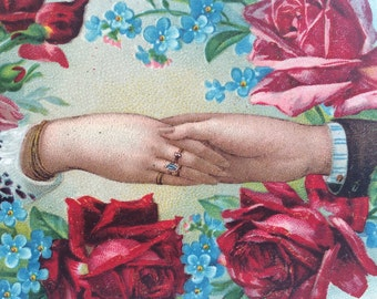 Collectable vintage Birthday postcard. Hands holding surrounded by roses. Romantic postcard.