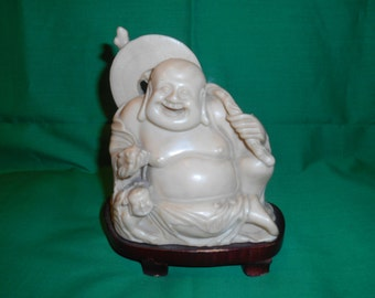 One (1), Laughing Buddha Figurine, on Wooden Stand.