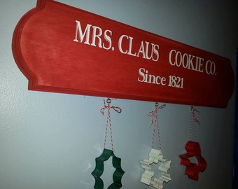 Mrs. Claus Cookie Co. sign with cookie cutters