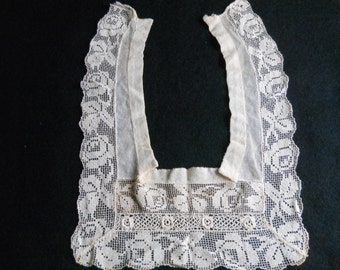 Antique lace inset, square. Attaches behind neck.