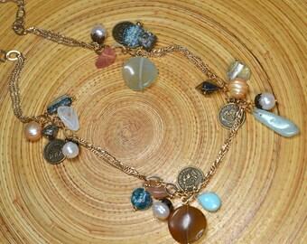 Exotic amulet necklace Bohemian dangle necklace Aqua ancient Roman glass bead Bronze replica coin necklace Gold chain necklace
