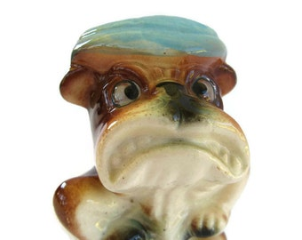 vintage angry dog figurine in a blue cap, ceramic bulldog, 1960's