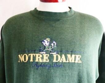 go UND Fightin' Irish vintage 90's University of Notre Dame dark forest green fleece College graphic sweatshirt crewneck embroidered logo lg