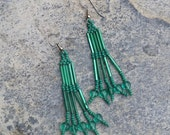 Fun and lovely dark green beaded earrings with cute glass hearts