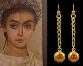 Beautiful crafted 22k gold earrings on chain by ann biederman