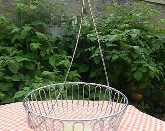 Vintage basket with silver metal hook for bananas.