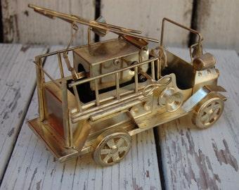 Vintage brass hook and ladder firetruck. Musical brass fire truck. Vintage brass fire truck