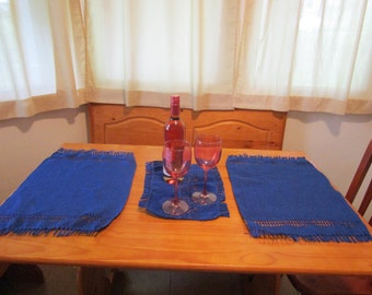 Royal blue placemats with candle cloth