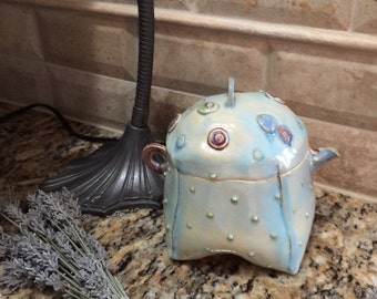 Ceramic puffy teapot