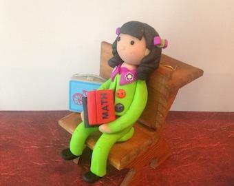 Polymer clay school girl,handmade polymer clay books,library,media,clay dogs,reading lady on the beach, summer reading,art dolls