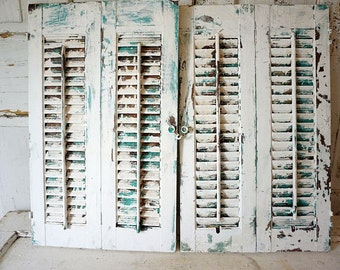Dirty white wooden shutters shabby cottage chic salvaged wood shutter set faded aqua blue accented painted home decor anita spero design
