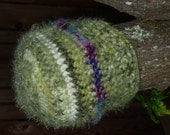 Crochet Beanie Hat in Green tones with purple contrast.  Fluffy textured yarns add style.