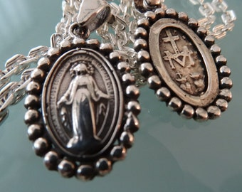 Miraculous Mary medal. Sterling silver double sided. Markings in back.