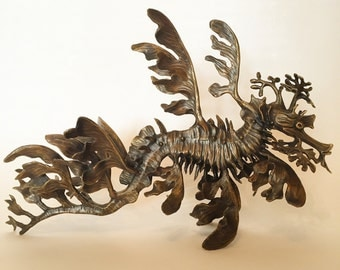 Bronze horizontal sculpture leafy sea dragon seahorse by Kirk McGuire