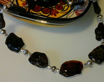 Stunning genuine free form dark cherry amber and sterling silver beads