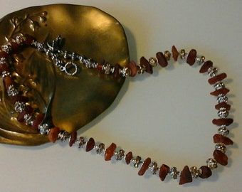 Unexpected combination of raw amber and rhinestones