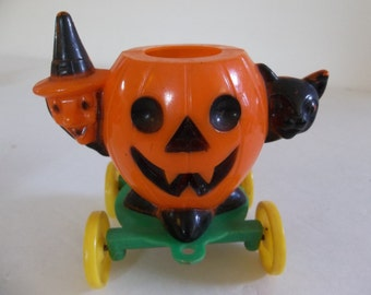 Vintage pumpkin halloween candy container on wheels, pumpkin black cat witch on wheels ,