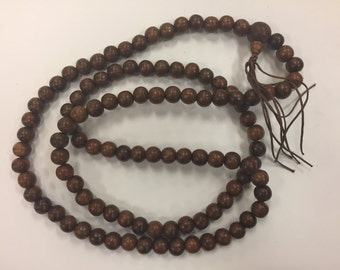 "Beaded wood necklace with tassel, walnut wood beads, 10mm, around 36""long"