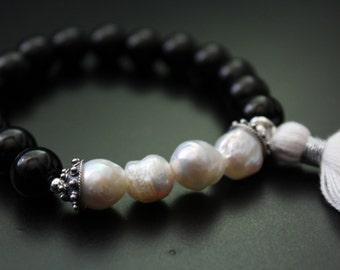 SALE Originally 34.00 Now 27.00 - Onyx and baroque pearls bracelet, tassel bracelet, Bali bracelet, boho stretch black and white bracelet