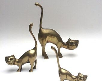 Set of 3 brass, primitive cats, figurine