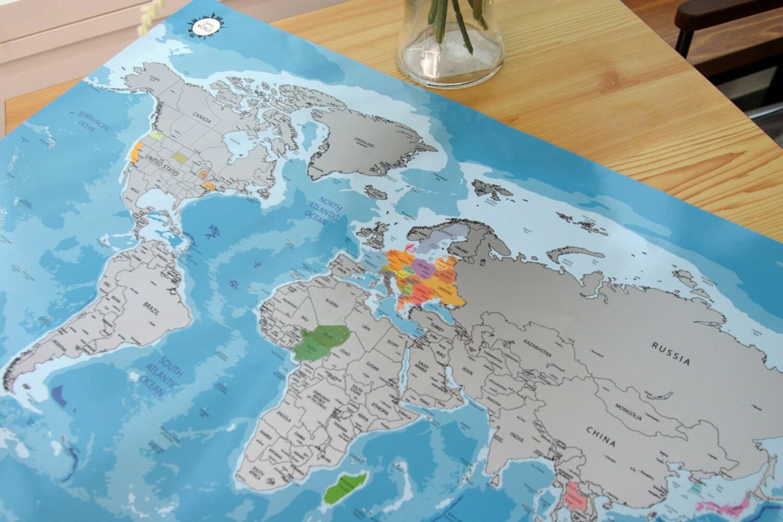 scratch off world map poster blue bg. Black Bedroom Furniture Sets. Home Design Ideas