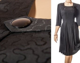 Lovely 1950's vintage classic black embossed rayon fabric elbow length sleeve back zip fastening flared tea dress - DB233