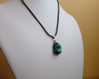 Turquoise pendant on leather cord