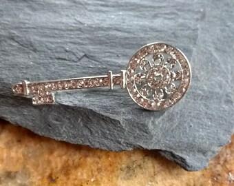 Unique vintage rhinestone silver colour key brooch, sparkly clear stones