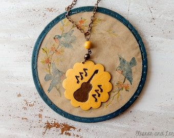 Flower child guitar necklace / music necklace / guitar necklace / hippie / boho necklace / upcycled jewelry / mustard yellow / revived