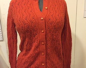 Vintage 1960s red-orange British Vogue cardigan sweater