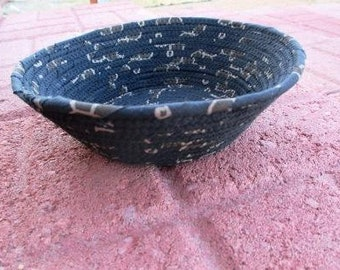 Black and tan colored fabric covered clothesline corded bowl